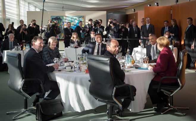 Prime Minister Theresa May speaks with German Chancellor Angela Merkel, US President Barack Obama, French President, Francois Hollande, the Italian prime minister, Matteo Renzi, and Spain's Prime Minister Mariano Rajoy during a meeting in Berlin with the leaders of the USA, Germany, France, Italy and Spain.