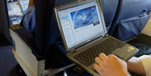 Stan Deal, Director of Commercial Sales for Connexion by Boeing surfs broadband internet while flying at 5,000 ft over London on one of the company's 737 jets. ... Transport - Connexion - Broadband Internet on Boeing Flights ... 29-07-2002 ... Farnborough ... UK ... Photo credit should read: Chris Ison/PA Archive. Unique Reference No. 1603620 ... The US firm's technical advancements allows passengers to watch live television broadcasts while in flight and transmission of large amounts of data in real time.