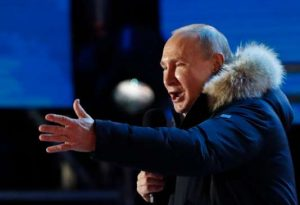 Russian President and Presidential candidate Vladimir Putin delivers a speech during a rally and concert marking the fourth anniversary of Russia's annexation of the Crimea region, at Manezhnaya Square in central Moscow, Russia March 18, 2018. REUTERS/Grigory Dukor